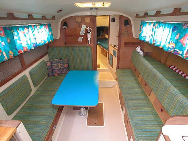 A privacy door separates the v-berth Pearson 33 1974 salon