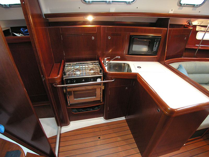 A hanging 2006 Beneteau 343 galley locker is to starboard, and to port is a ...
